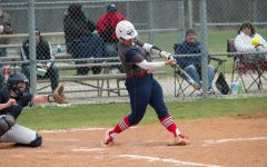 Softball splits conference doubleheader