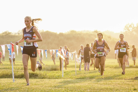Junior business major Alyssa Moore runs during the Stegemoller Classic at Angel Mounds in Evansville, Sept. 4. The team finished the NCAA Division II Championship in 10th place this season.