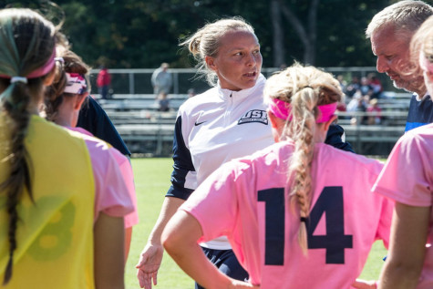 Women's head soccer coach Krissy Engelbrecht informs her players of the next play during the Kick for the Cure game in October.  Engelbrecht announced her resignation after 13 years as the head coach.