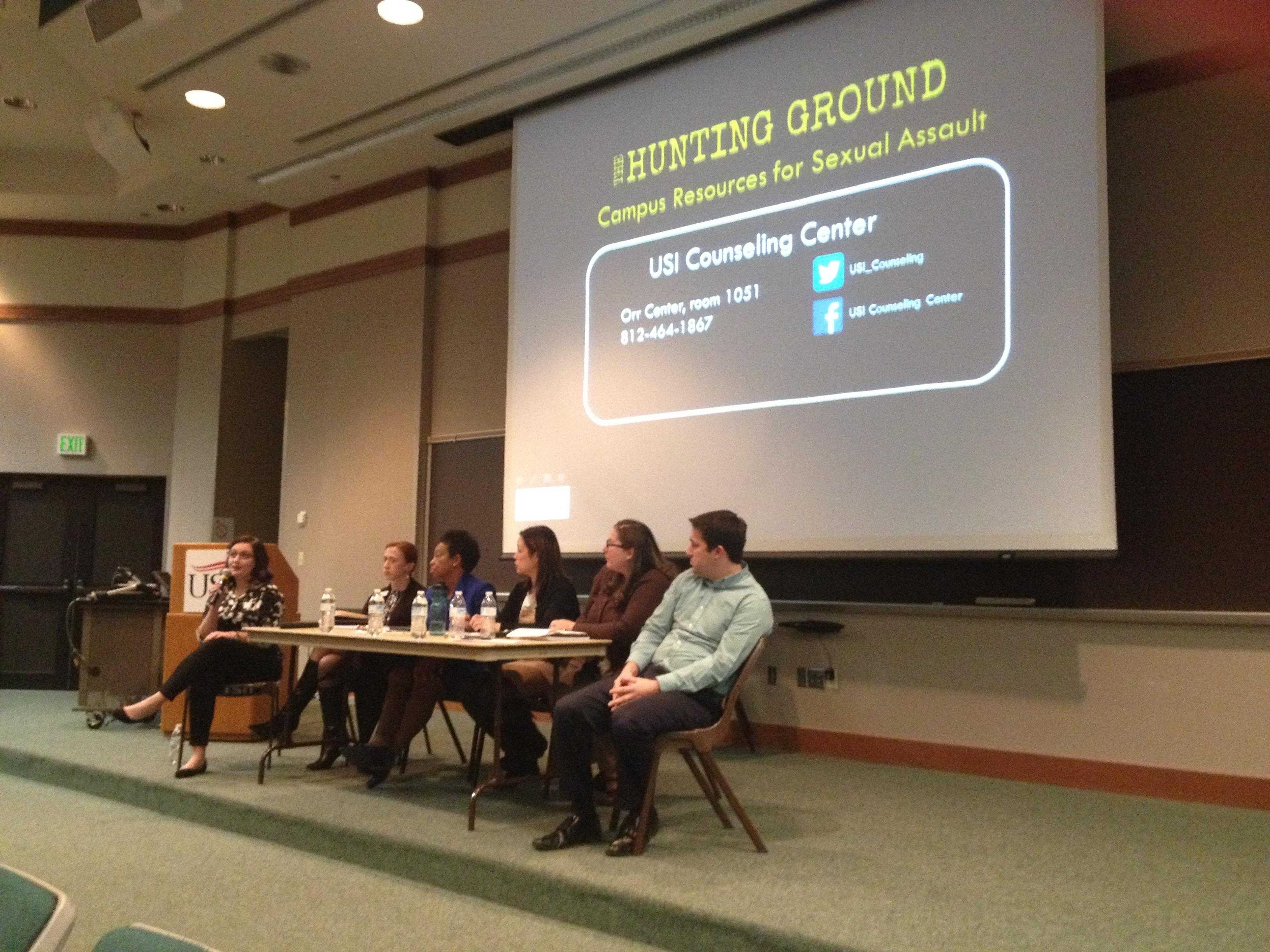 """Panelists reflect on """"The Hunting Ground"""" following a screening Tuesday in Mitchell Auditorium. Audience members asked the panelists questions aloud or submitted a sensitive or anonymous question in writing."""
