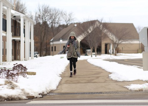 Sophomore art major Theanoe Christos bundles up as she walks to class from the campus apartments Monday morning. The university was closed Friday because of weather conditions.