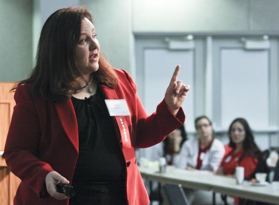 """Patient rights advocate and speaker Regina Holliday shares her story at the first Health Informatics Tri-State Summit in 2014. Summit chairperson Gabriela Mustata Wilson said she looks for """"powerful patient stories"""" when selecting conference speakers."""
