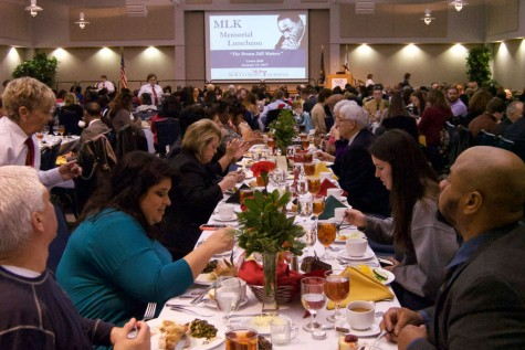Guests to the Martin Luther King Jr. Luncheon are served their meals before the guest speaker takes the stage during the 2015 annual event in Carter Hall. This year's luncheon will include guest speaker Major General Barrye L. Price, the first African American to obtain a doctorate from the Department of History of Texas A&M University.