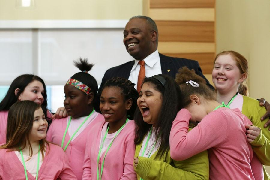 """The Alpha Kappa Alpha sorority sponsored after school group, Emerging Young Leaders, laugh with Martin Luther King Jr. Luncheon's keynote speaker Major General Barrye Price after his """"Up Close and Personal"""" meeting in Traditions Lounge on Monday."""