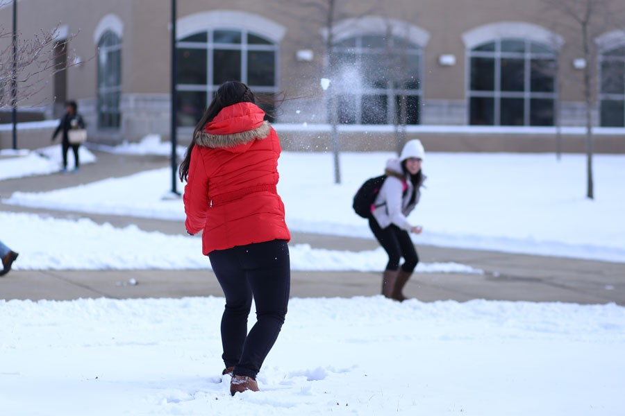 Sanabria (left) retaliates after fellow international student Deena Bregheith, a junior English major from Palastine, initiates a full blown snow ball fight in the Quad Thursday.