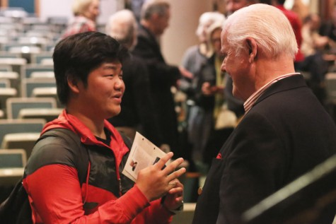 Freshman undecided major and international student Soo Sung Chung (left) asks Guinness (right) about how he can take the ideas from the presentation and use them to change other countries Wednesday night.  Chung was one of the many attendees who lined up to meet Guinness after the question and answer session.