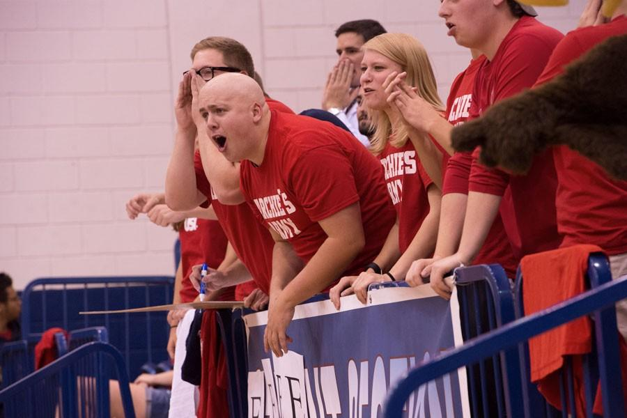 Students cheer on the women's volleyball team during a home game against Quincy University at the PAC last fall.