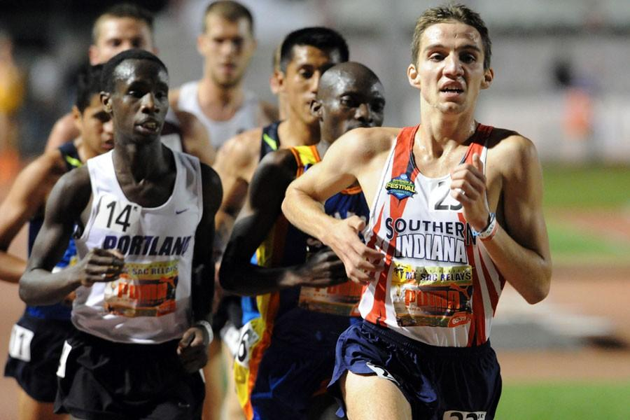 Former USI runner Dustin Emerick leads the pack during the Division II National Championship. The assistant track and field and cross country coach at USI is set to run the Olympic Trials Marathon in California Feb. 22.