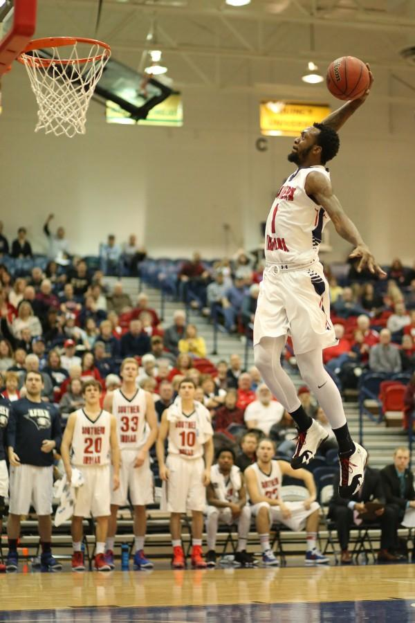 Junior guard Jeril Taylor leaps to dunk during the second half of the men's basketball game against Truman State University Saturday in the PAC.