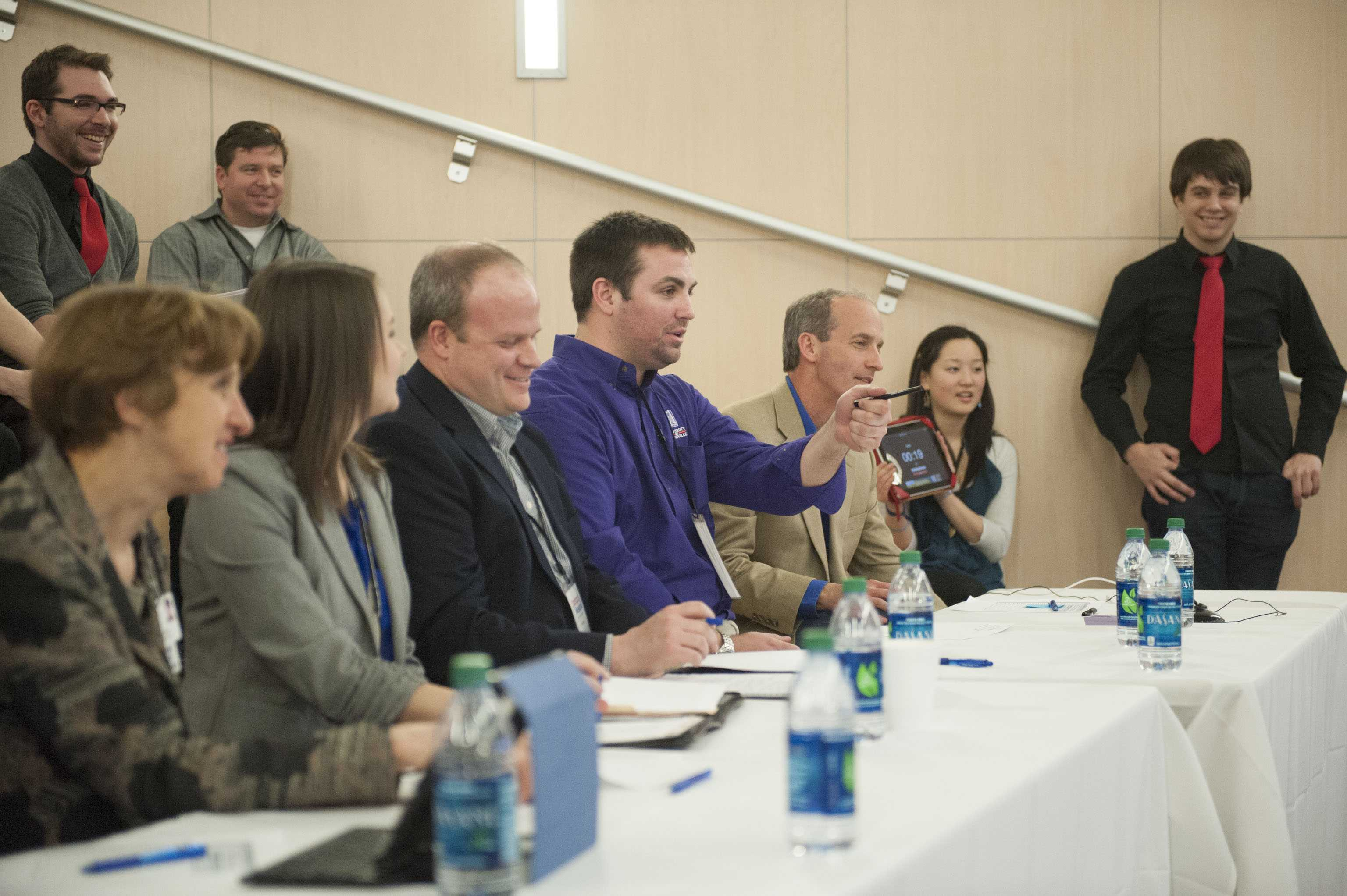 The judges at Startup Weekend Evansville 2015 ask questions about a participant's idea during the Friday round. At this stage each year, 10 participants are selected to move on to the final stages.