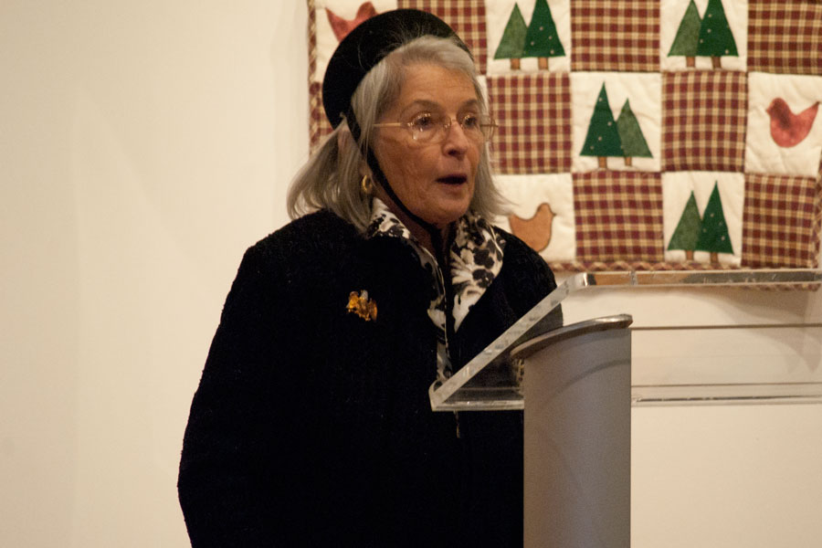 Judy Morton, a university alumn, speaks during the exhibit's reception on Sunday in the Pace Gallery. Morton and late husband Tom Morton donated the Morton Quilt Collection to the university in 2013.