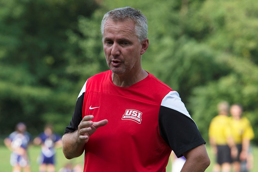 Eric Schoenstein, the newly appointed head coach of women's soccer, talks to players last year during a game. Schoenstein spent two years as assistant coach before he was hired to replace former head coach Krissy Engelbrecht.