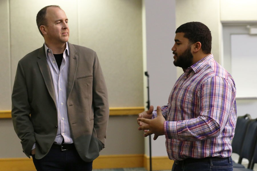 Senior Finance major Terrance Lewis asks Doug Field, vice president, engineering, Tesla Motors, Inc., for advice on his career path in Carter Hall on Monday. Field was invited to speak on campus and is serving as the 2016 Executive in Residence for the Romain College of Business.