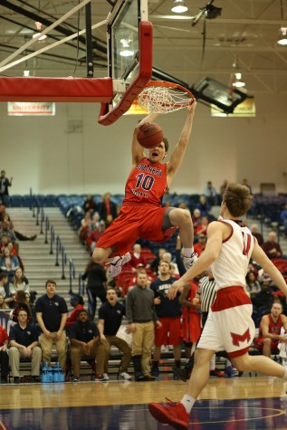 Freshman forward Jacob Norman dunks during the second half of the men's basketball game against Maryville University in the PAC Thursday. Maryville won 89-80.
