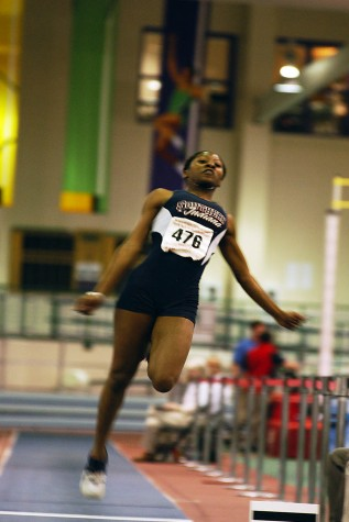 Candace Perry Fairer completes a long jump attempt during a meet in 2005. Fairer is one of the six inductees into this year's athletic hall of fame.