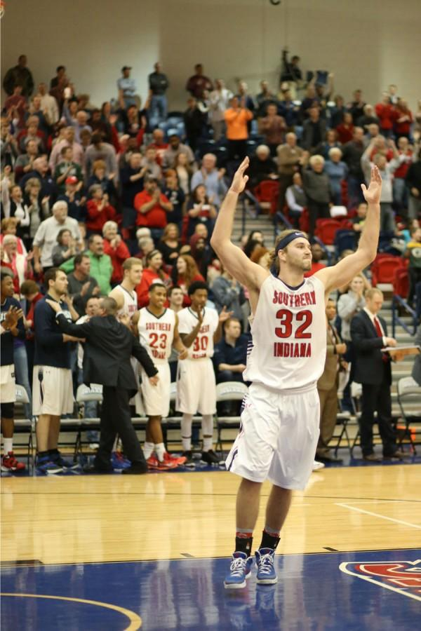 As the crowd cheers, Seniour puts his arms in the air with celebration as the Eagles defeat the Knights 89-82.