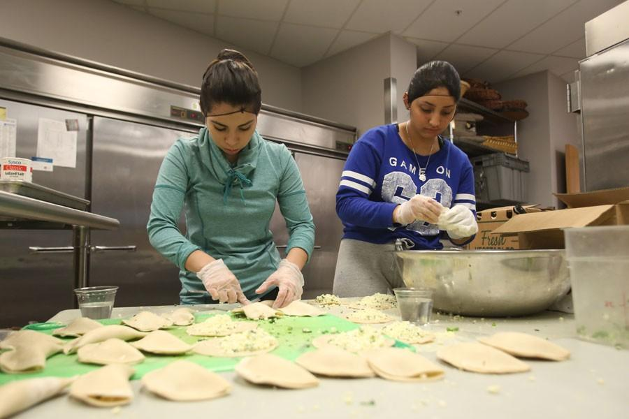 Representing Ecuador, Evelyn Lopez (left), a junior business administration and Spanish double major, and Jackeline Yagual (right), a sophomore psychology major, prepare empanadas Thursday in The Loft's kitchen. The empanadas were served at the International Food Expo Friday in Carter Hall
