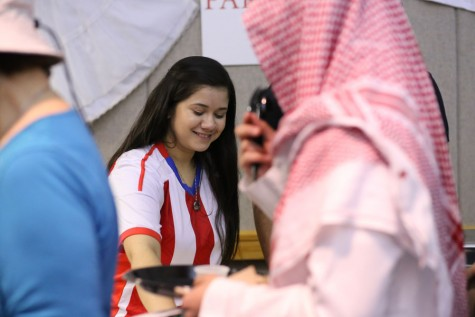 Sandra Sanabria, a junior international studies major, shares a dish from Paraguay, her home country during the International Food Expo Friday in Carter Hall.