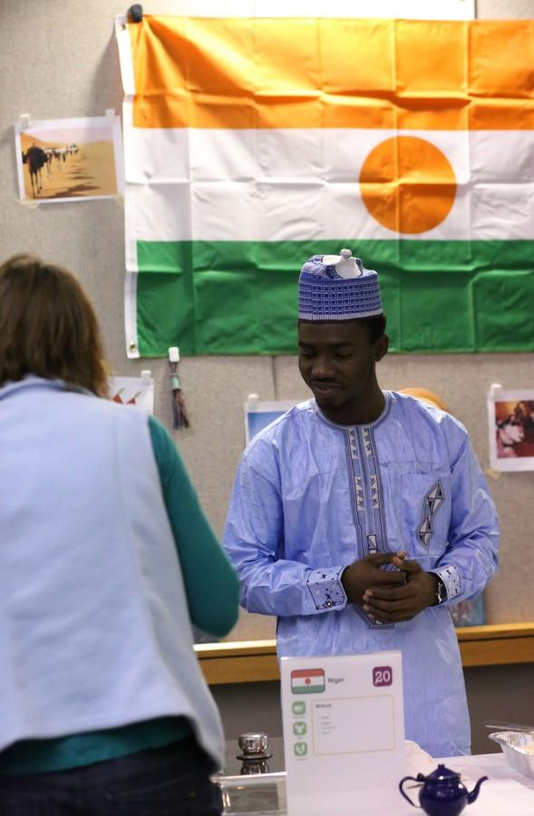 Souleymane Mamane Illia, a junior English major, represents his home country of Niger Friday at the International Food Expo in Carter Hall.