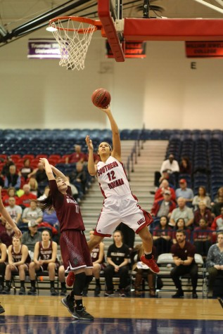 Junior forward Tasia Brewer shoots for two during the first half of the women's basketball game against Bellarmine University Thursday in the PAC. The Eagles lost with a score of 59-87.