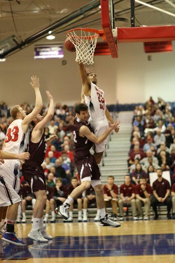 Britt goes for a layup during the first half of the last home game of the season against Bellarmine.