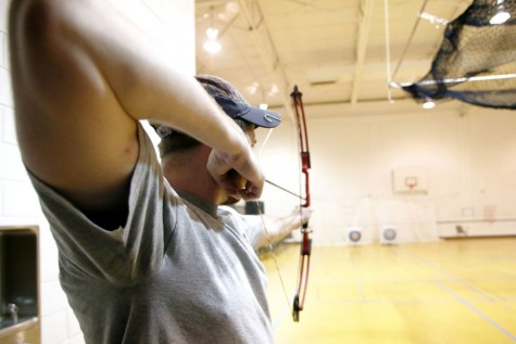Senior engineering major Zach Clem aims his arrow during Archery Club practice March 2, at the Physical Activities Center.