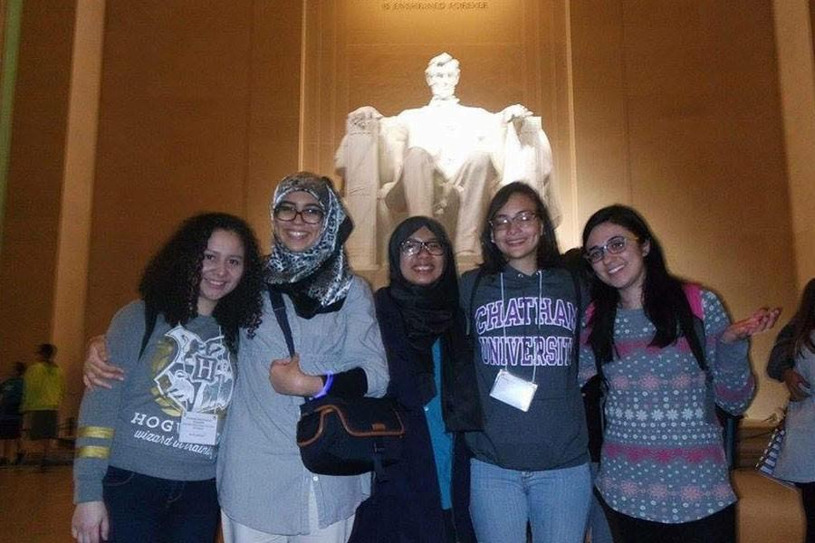 Deena Bregheith (far right), a junior English major, joins her friends in front of the Lincoln Memorial during her trip to Washington, D.C.