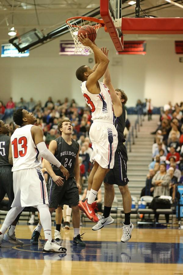 Senior guard Travis Britt shoots for two during a game against Truman State University January in the PAC