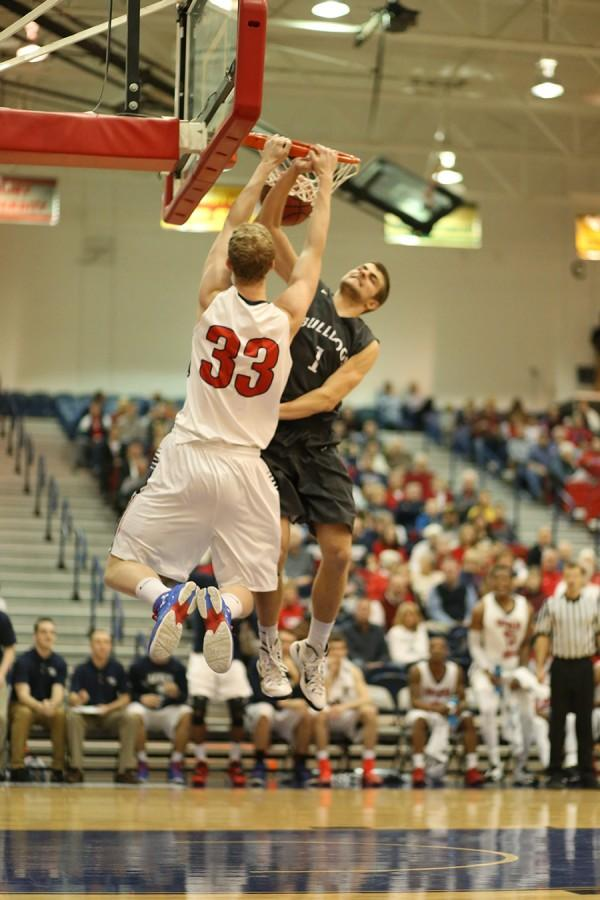 Sophomore center Davis Carter dunks during the second half of a game against Truman State University January in the PAC.