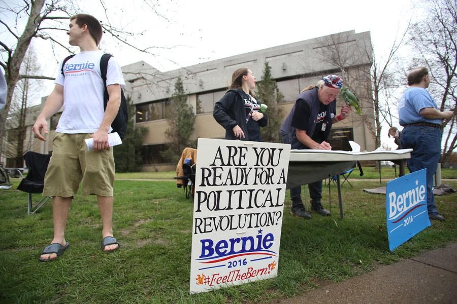 Students and volunteers ask those walking by if they have registered to vote yet during the Sanders rally Thursday in the Free Speech Zone. Although the group was told they were not allowed to do voter registration by the Dean of Students office, the volunteers still gave out information on where and how to register.