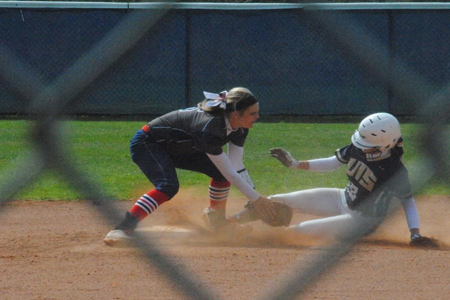 Freshman Lindsey Barr attempts to tag out a member of the University of Illinois Springfield team before she reaches her base during the March 25, game at the USI Softball Field. The infielder/catcher had two RBIs and scored two runs and a home run during the game.