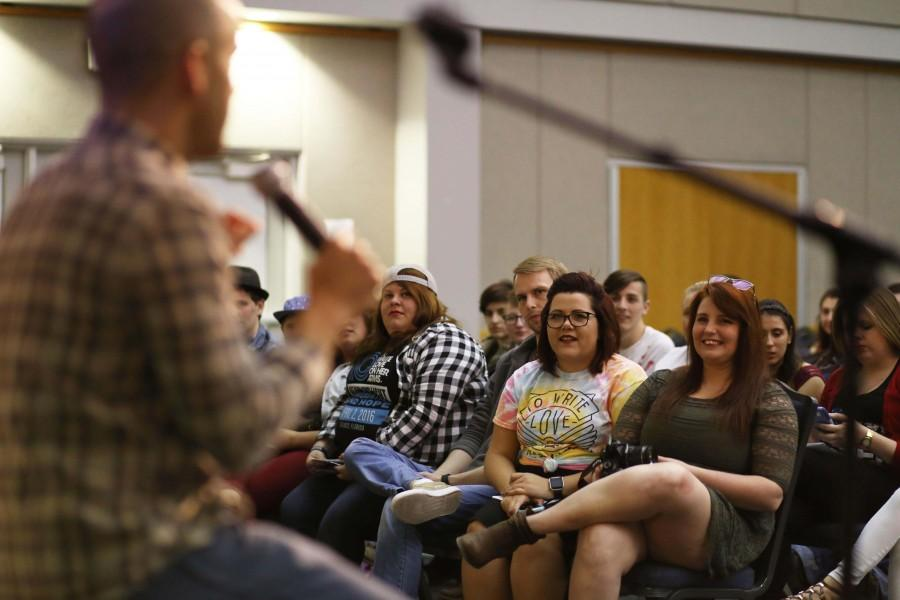 Aaron Moore, a licensed mental health counselor, talks to Erin Gillingham, founder of the To Write Love on Her Arms university chapter at USI, and Robbillie Stevenson, the previous president of the chapter, after speaking at the organization's event Tuesday in Carter Hall.