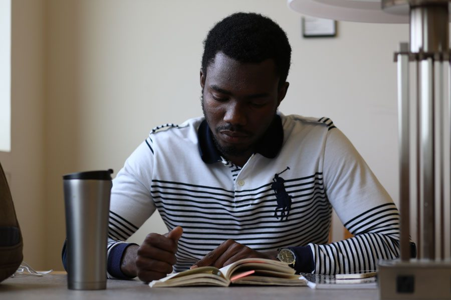 Souleymane Mamane Illia, a junior English major from Niger, studies for finals Tuesday at Rice Library. Illia will return to Niger after finals and said he will miss his friends, professors and advisers who made his experience in the United States great.