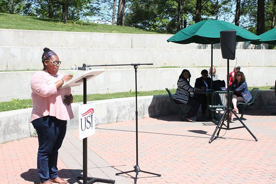 """Danesha Shelton, social work senior, provides a self-written monologue at the Stand Against Racism rally put on by the YWCA at the Amphitheatre on Thursday. """"Is it enough today? If I hear it one more time I'll say something. That's it, I'm going to say something. These are thoughts that I have a lot. It's a routine that I have not yet established. It takes 30 days to form a habit, in those 30 days I ask you how many social injustices did you see? How many racist jokes did you hear, more than 30? Did you say something every time, did you stand up against it? When will it be enough for you? Is it when another person dies, another protest, another riot, another violent rally? Is it enough today? Will you stand against racism today?"""""""