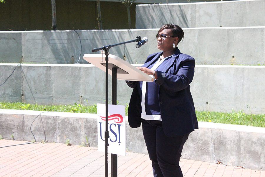 """Veronica Huggins, professor of social work, speaks at the Stand Against Racism rally put on by the YWCA at the Amphitheatre on Thursday. """"We do have to acknowledge that racism exists, we have to commit to cultural humility, and people may place you within their bandwidth but you do not have to accept,"""" Huggins said."""