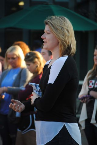 Incoming SGA President Ashley Wright listens as speakers wrap up the Walk a Mile In Her Shoes event Tuesday at the University Center Amphitheatre. Wright will be inaugurated April 14.