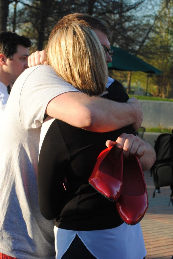 """Incoming SGA President Ashley Wright hugs Jason Minor, SGA chief justice, during the annual Walk a Mile in Her Shoes event Tuesday at the University Center Amphitheatre. """"The event hit closer to home than expected,"""" Wright said."""