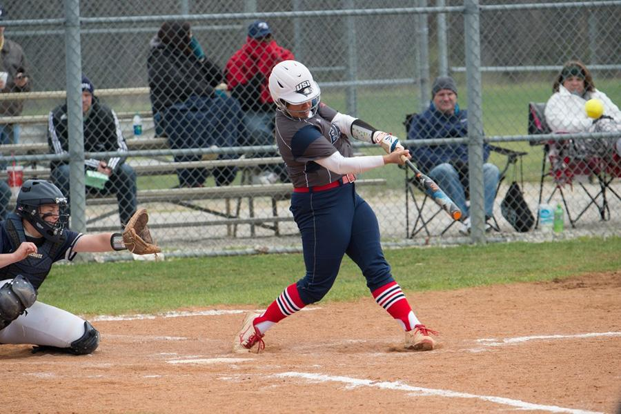 Junior pitcher/infielder Haley Hodges steps into her swing during the team's double header against the University of Illinois-Springfield March 25. Hodges recently became the softball player with the most single-season home runs in USI history.