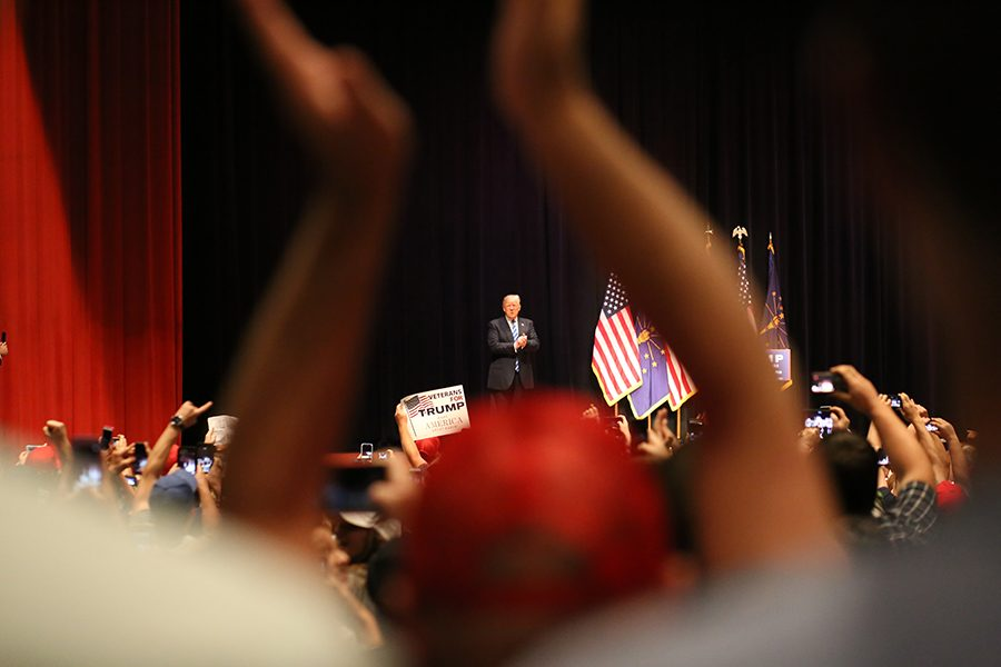 Republican presidential candidate Donald Trump takes to the stage as many supporters stand and welcome him Thursday at the Old National Events Plaza in Downtown Evansville.