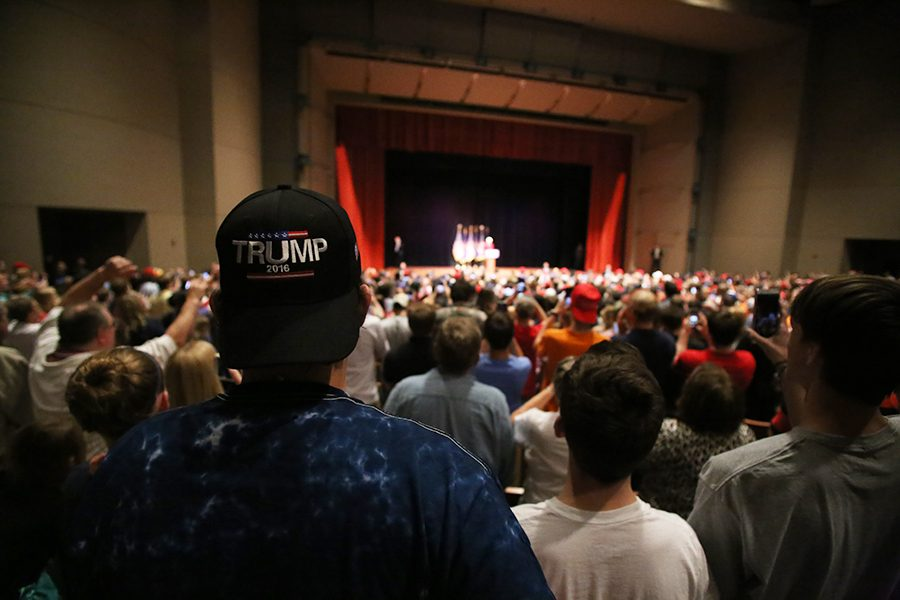 Many attendees take out their cell phones as former Indiana University basketball coach Bobby Knight speaks at the beginning of the Trump rally.