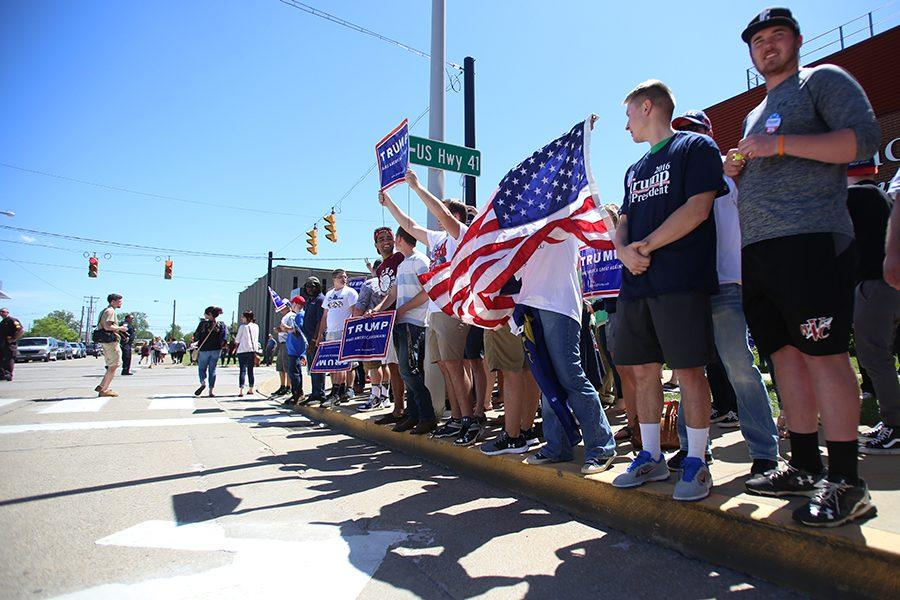 Trump supporters lined the opposite side of the road to counter act the protestors after the rally Thursday.