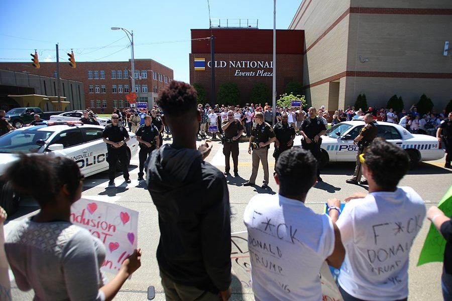 A line of police officers stood between Trump supporters and protestors as they were asked to stay on the sidewalks outside of the Old National Events Plaza where the Trump rally took place.