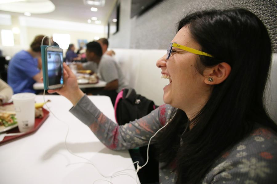Junior English major Deena Bregheith laughs with Raheil Inaim, a childhood friend, on FaceTime Tuesday at The Loft. Inaim grew up with Bregheith in Palestine but moved to Canada after high school and they only see each other when Inaim visits her home country.