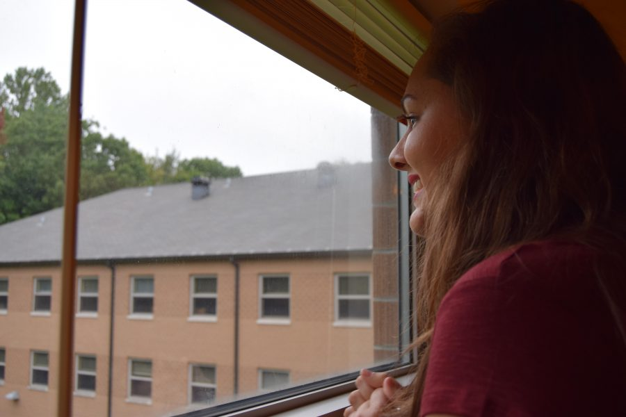 "After unlocking her dorm room for the first time, Fredrick gazes out of her window in Governors Hall. ""It's my new backyard,"" she said to her mother, pointing out how green the view is compared to California."