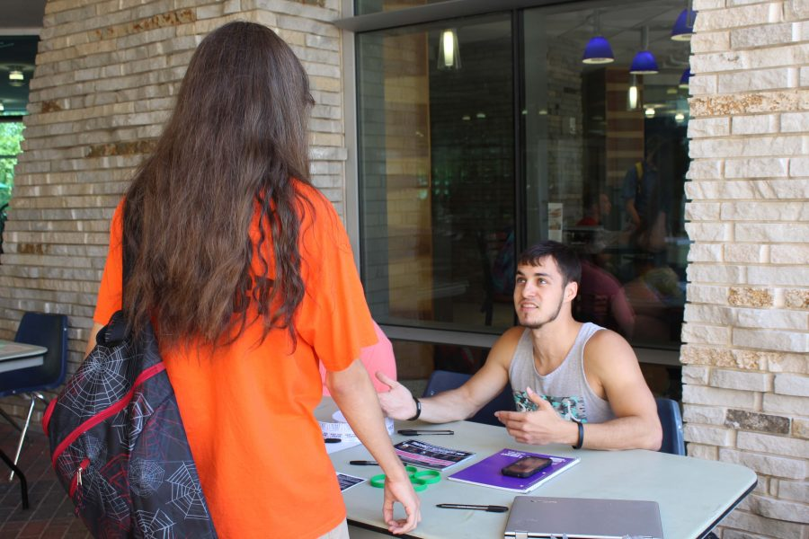 Zach Barrett, a senior exercise science major, speaks with a potential freshman recruit about joining Lambda Chi Alpha.
