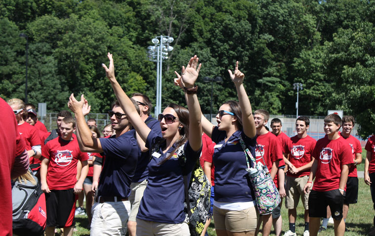 Students participate in a chant for their individual colleges during last years Welcome Week. Each college works to be the loudest as they walk into the Physical Activities Center.