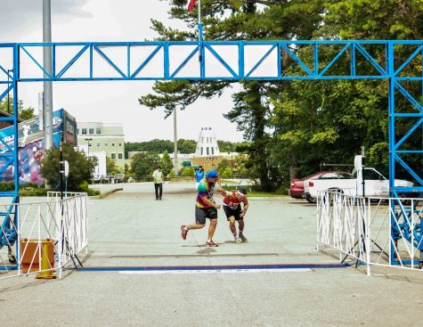 Zach Price and Leo Scheller cross the finish line of the Inaugural Phi-K. The race was both a 5k and a one mile walk and all of the proceeds went toward funding research for ALS.