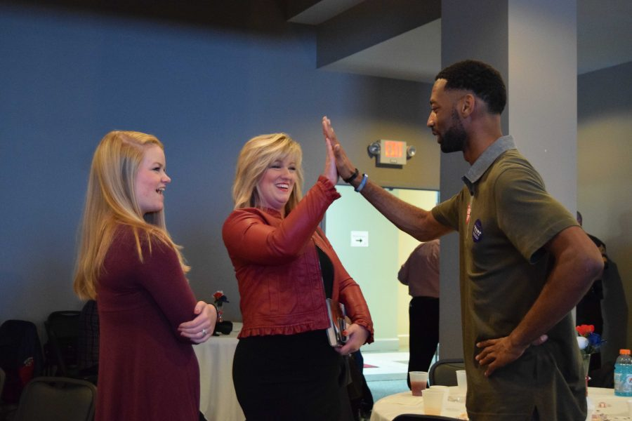 Former USI College Republicans President Donovon Phipps high-fives Holli Sullivan, a confirmed state representative after election night. The two shared a celebratory moment alongside Sullivan's daughter Savannah as the Republican Party claimed the majority of local election wins.