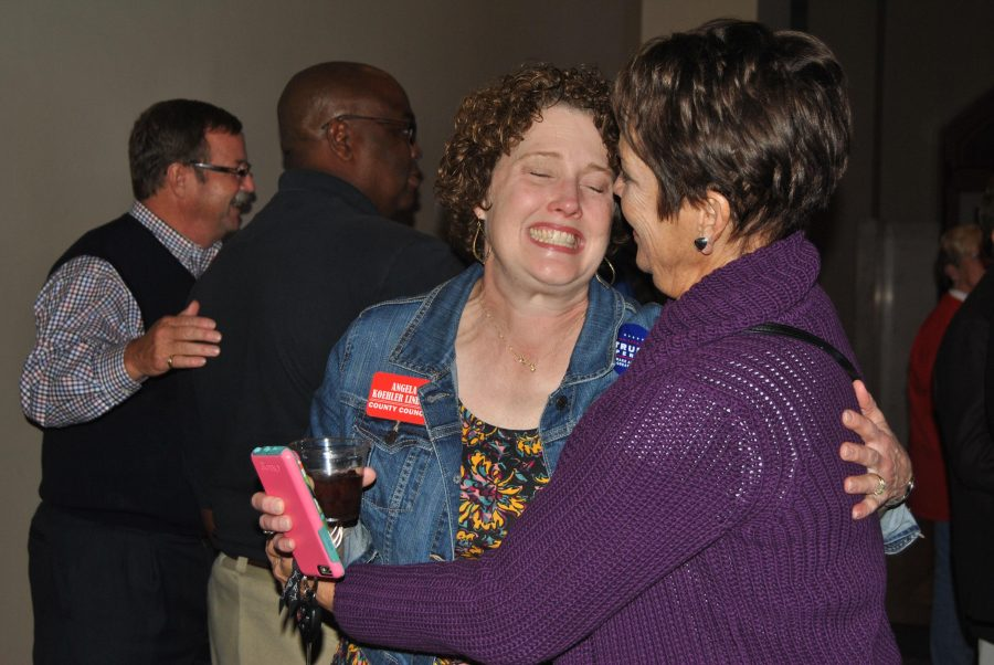 One of the three candidates elected for County Council, Angela Koehler Lindsey, R, sheds tears of joy and hugs of congratulations from friends and supports on her victory Tuesday night at the Republican Watch Party. Lindsey said it has been a long process and she is relieved the election has finally come to a close.