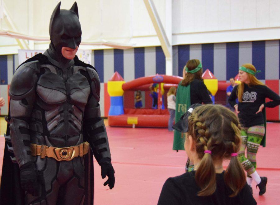 Patrick Hodges, dressed as Batman, talks to Reagan Hopf, a Riley kid. Hodges has dressed as Batman since his son Josiah was treated at Riley Hospital for leukemia.
